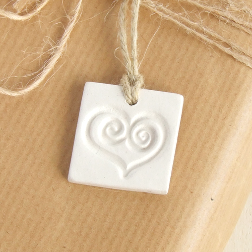 Handmade square white clay gift tags ornament with a heart imprint