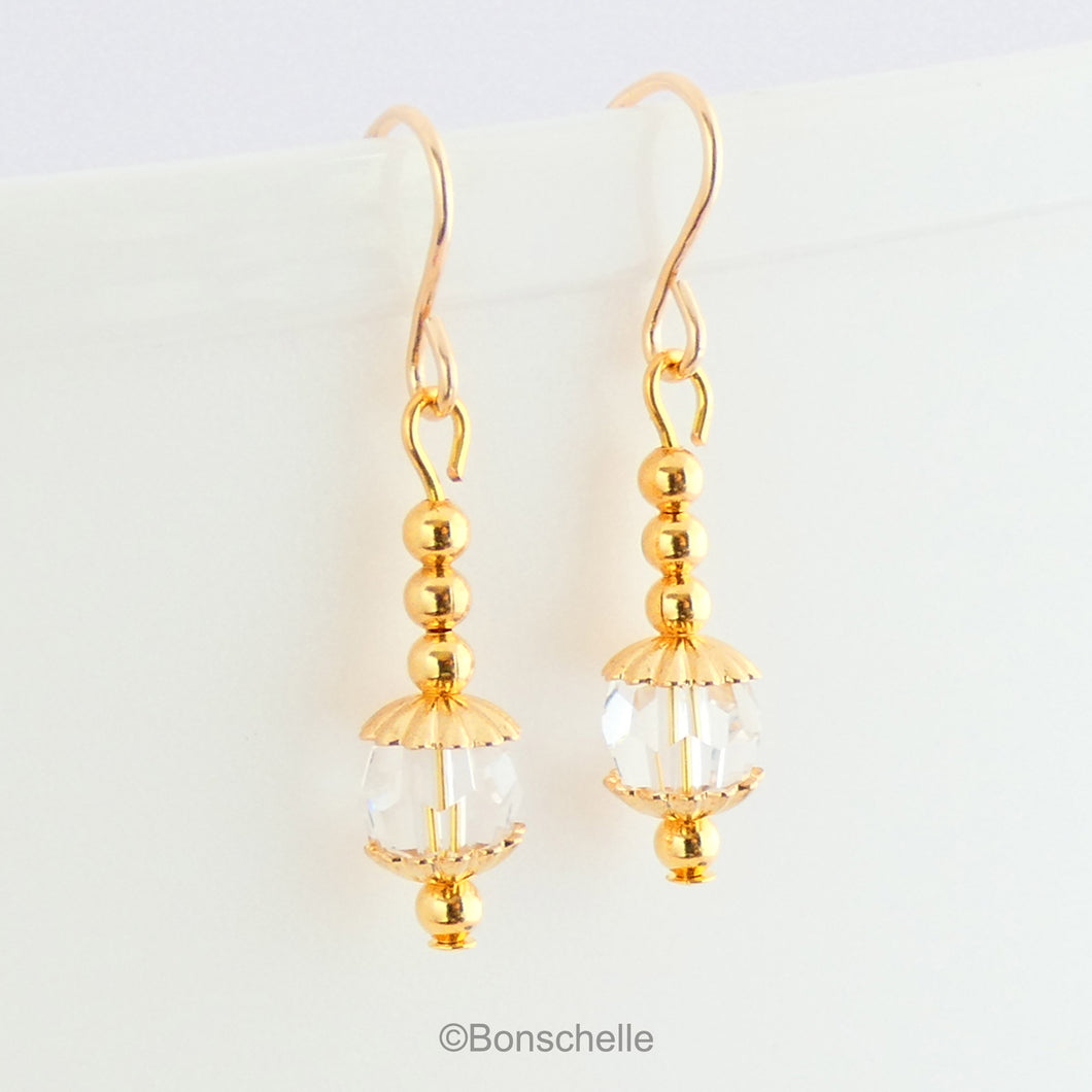 Handmade earrings with clear Swarovksi faceted crystall glass beads, gold tone small beads adn 14K gold filled earwires
