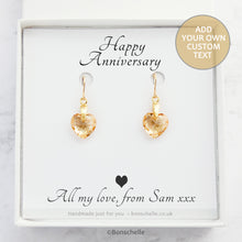 Load image into Gallery viewer, Handmade earrings with pale golden bronze toned Swarovski crystal heart earrings and 14K gold filled earwires in a jewellery box with a personalised gift message.