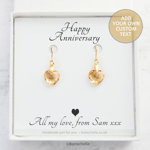 Handmade earrings with pale golden bronze toned Swarovski crystal heart earrings and 14K gold filled earwires in a jewellery box with a personalised gift message.