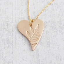 Load image into Gallery viewer, Gold bronze heart shaped pendant with leaf pattern on the front