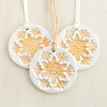Load image into Gallery viewer, Round White clay Christmas decoration with gold snowflake pattern 1