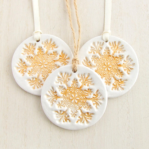 Round White clay Christmas decoration with gold snowflake pattern 1