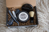 KC Shave Co. offers a sharpened straight razor, shave soap, shave bowl, and boar hair's shave brush.