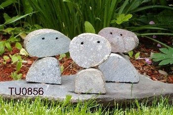 Stone faces, 3 figures