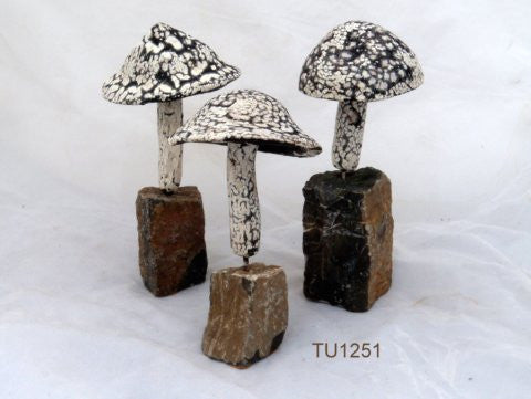 Three Ceramic mushrooms