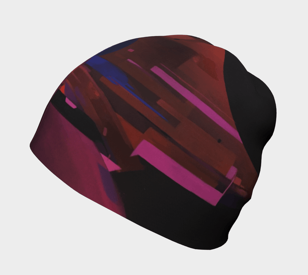 Left side view of the classic City Beanie hat illustrated by Street Artist Ankhone. This abstract red, blue, black and purple pattern was inspired by a city. for men and women and adult and children