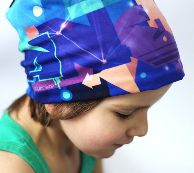 Boy wearing Lalita's Art Shop colourful Galaxy Grow-with-me beanie by Ankhone