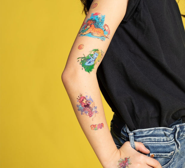 Exemple of the colored temporary tattoos collection Girls illustrated by Ankhone on a child's arm.