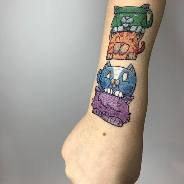 LAST1022 - exemple of the create your cat totem pole removable tattoo on a child arm. the collect real art, fake tattoo illustrated by professional cartoonist Andre Martel