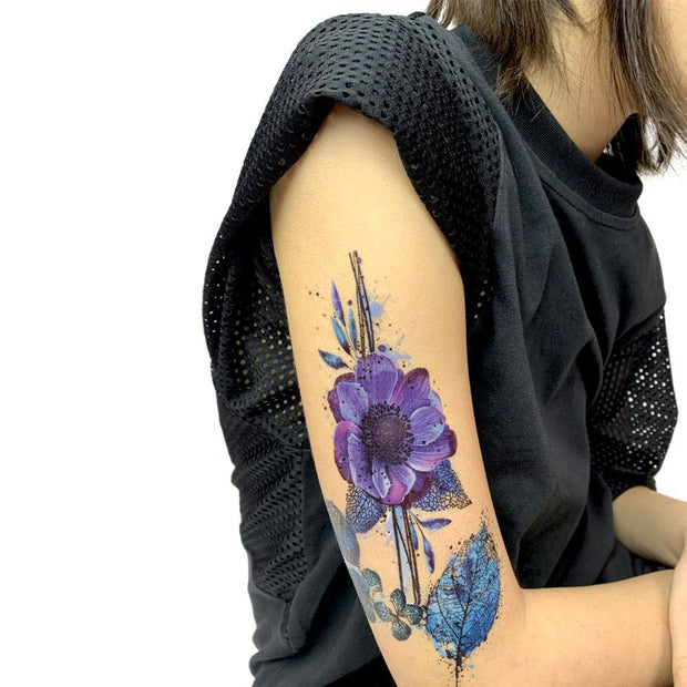 Exemple of the watercolor botanical removable tattoo collection illustrated by professional tattoo artist Julie L'Ecuyer on a girl's arm. Women's and girl's tattoos.