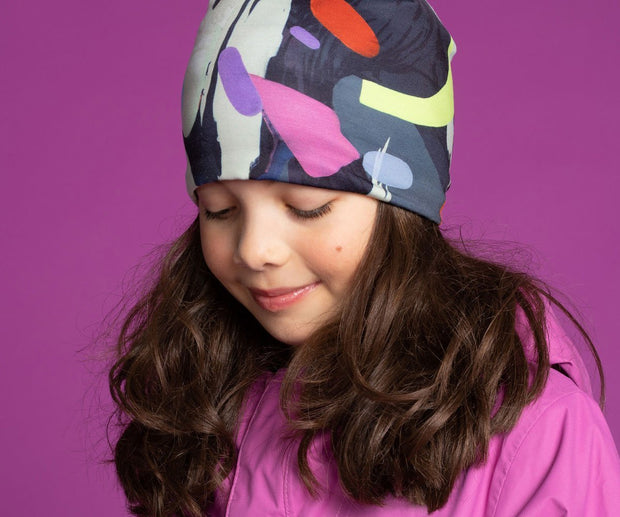 Girl wearing Lalita's Art Shop colourful sport beanie hat by Ankhone