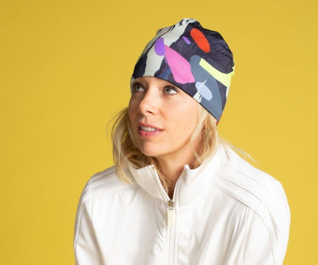 Woman wearing Lalita's Art Shop Crow beanie hat illustrated by street artist Ankhone