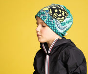 Boy wearing Lalita's Art Shop green Diving Beetle by Canadian Artist André Martel