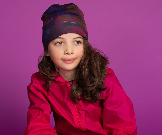 Girl wearing the Lalita's Art Shop City sport beanie designed by Canadian artist Ankhone