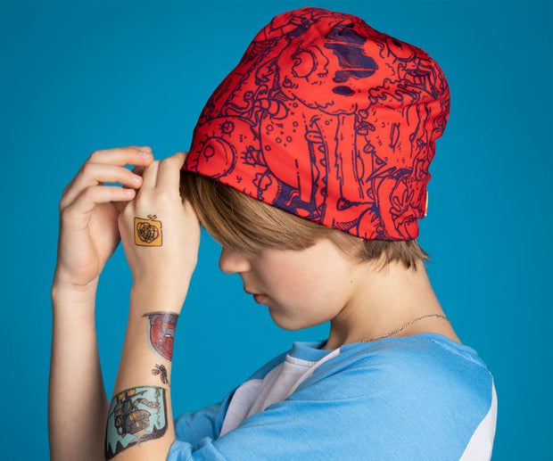 Boy wearing the red and blue Lalita'S Art Shop Monsters beanies hat by artist Andre Martel