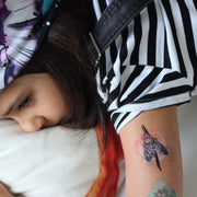 Exemple of the colored Bugs and crawlies removable tattoo collection  illustrated by professional tattoo artist Julie L'Ecuyer on a child's arm.
