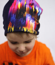 Boy wearing Lalita's Art Shop colourful Some Things You can't Explain Stroke Grow-with-me beanie.