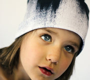 Child wearing Lalita's Art Shop Abstract Brush Stroke Grow-with-me beanie.