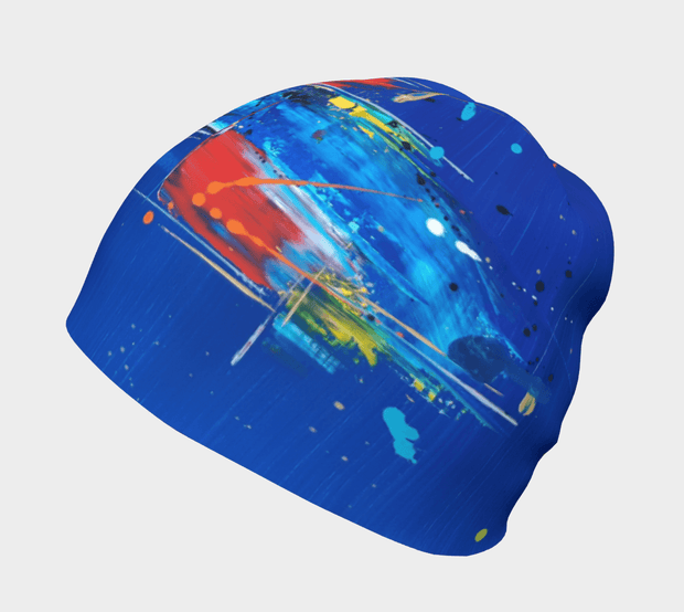 Left side view of the blue, and red and white abstract patterned toque illustrated by artist Megan Fortin