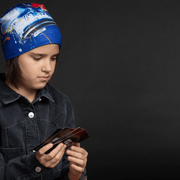 Girl wearing the beautiful blue abstract beanie hat for adults and kids