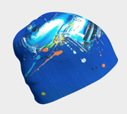 right side view of the blue abstract beanie hat designed by the painter Megane Fortin.
