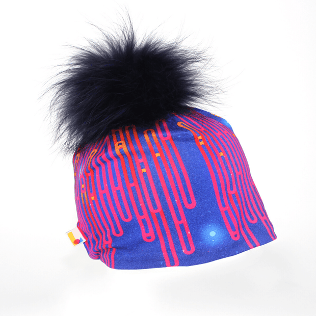 Right side view of the bamboo beanie with detachable Navy blue Pompom for adults and children .