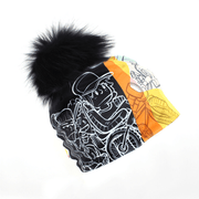 Darknees Vr Light black pom beanie hat designed by Andre Martel
