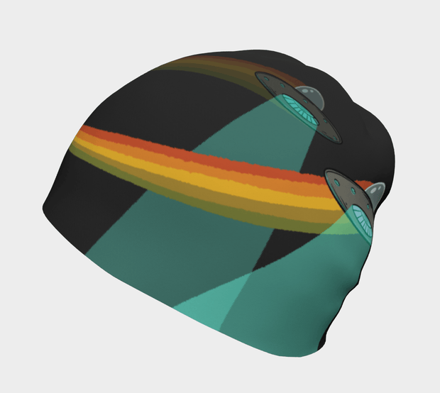 Right view of the Flying Saucer beanie hat illustrated by Artiste André Martel. you see a composition of 2 flying saucers with a orange, yellow and green rainbow on a black background..