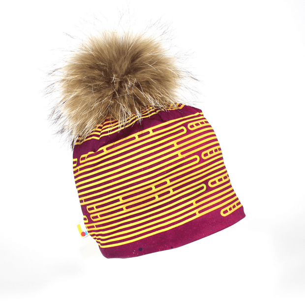 Right side view of the Magenta bamboo beanie for adults and children with big natural pompom