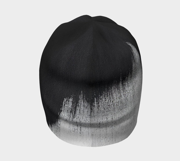 Rear view of Lalita's Art Shop Abstract Brush Stroke Grow-with-me beanie is the perfect hat to wear season after season and under your helmet. This black and white tuque is breathable with its bamboo lining and super comfortable