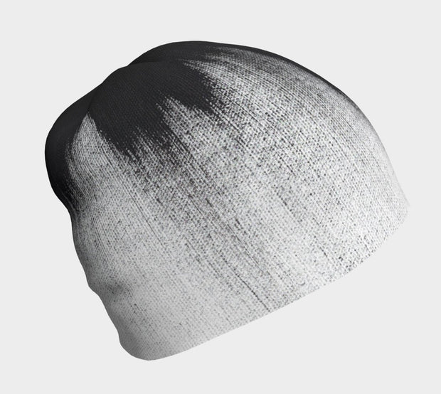 Lalita's Art Shop Abstract Brush Stroke Grow-with-me beanie is the perfect hat to wear season after season and under your helmet. This black and white tuque is breathable with its bamboo lining and super comfortable