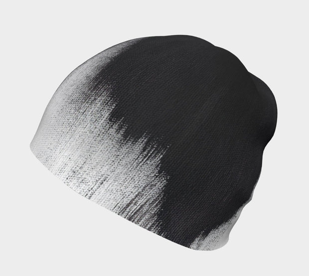 Side view of Lalita's Art Shop Abstract Brush Stroke Grow-with-me beanie is the perfect hat to wear season after season and under your helmet. This black and white tuque is breathable with its bamboo lining and super comfortable