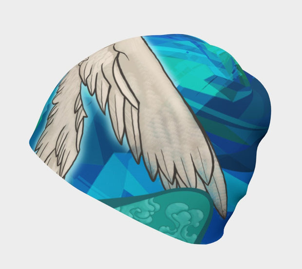 Side view of Lalita's Art Shop Head in the Clouds Grow-with-me beanie is the perfect hat to wear season after season and under your helmet. This colourful tuque is breathable with its bamboo lining and super comfortable