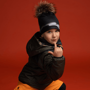 Boy wearing black Signature with natural fur pom. Best hats for kids and adults.
