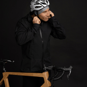 Young men taking off his bike helmet using Lalita's Art Shop's sport beanie illustrated by Megan Fortin as a helmet liner in cold season.