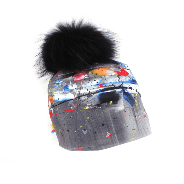 Side view of the Gray Wolf pom Beanie hat illustrated by young artist Megane Fortin