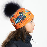 Left side view of the orange abstract with big  blue fur pom.