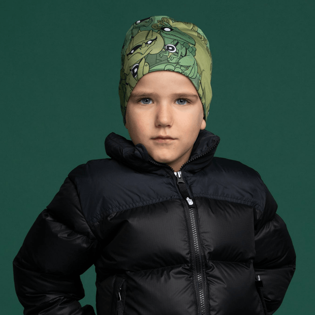 Boy wearing Lalita's Art Shop green toque with dinosaure patterns. Best Grow-with-me beanie for kids !