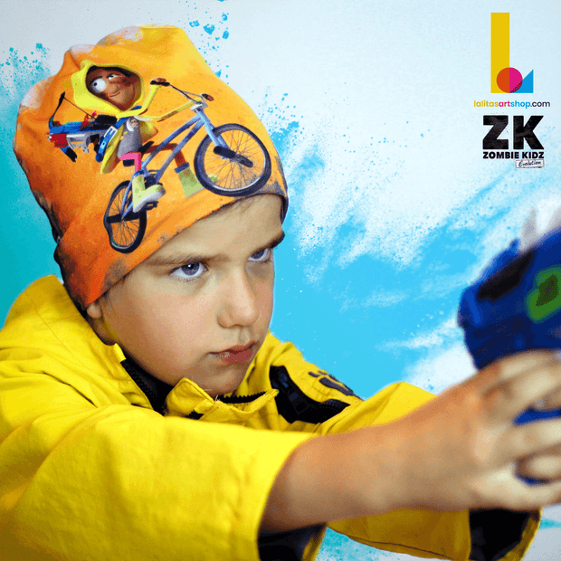 Boy in action wearing the The Zombie Kidz Bike Hero! This yellow, black and white  bamboo beanie was illustrated by illustrator NIKAO for the Zombie Kidz game by the canadian editor Scorpion Masqué.