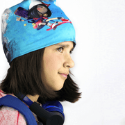 Side view of kid's tuque  created in collaboration with Canadian editor scorpion masque illustrating a young skater girl hero chasing zombies !
