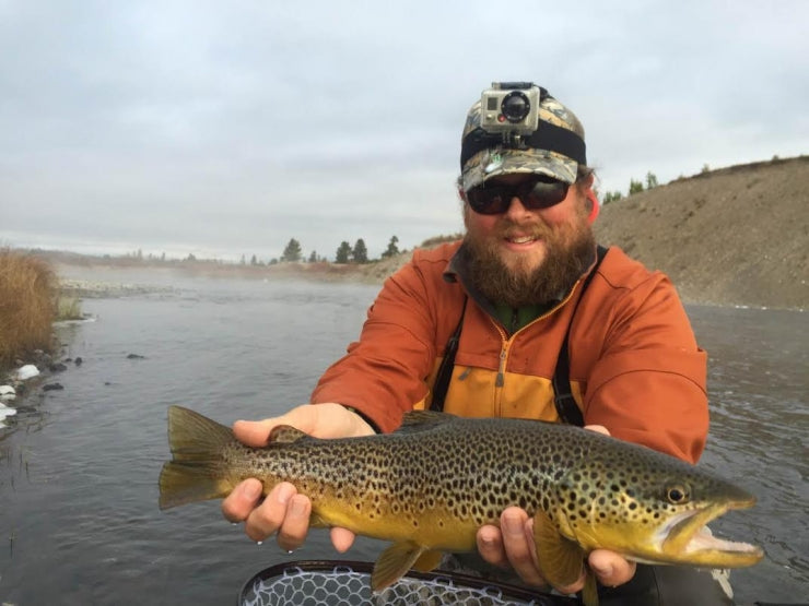 Chris Daniel Fly Fishing with a Brown Trout on the Madison River in Yellowstone National Park