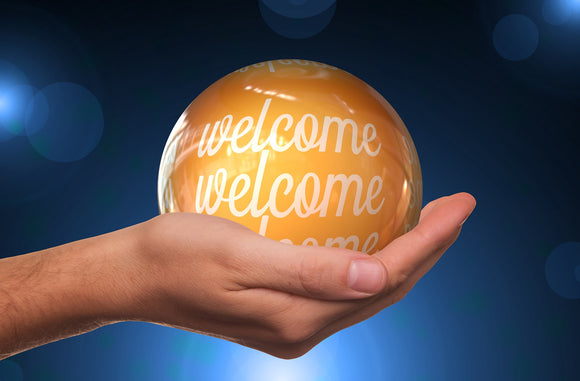 Image: Welcome written on globe, held in hand - E. John Robinson Official Site, Blog