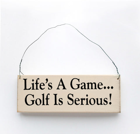 Wood sign saying: Life's a Game, Golf is Serious