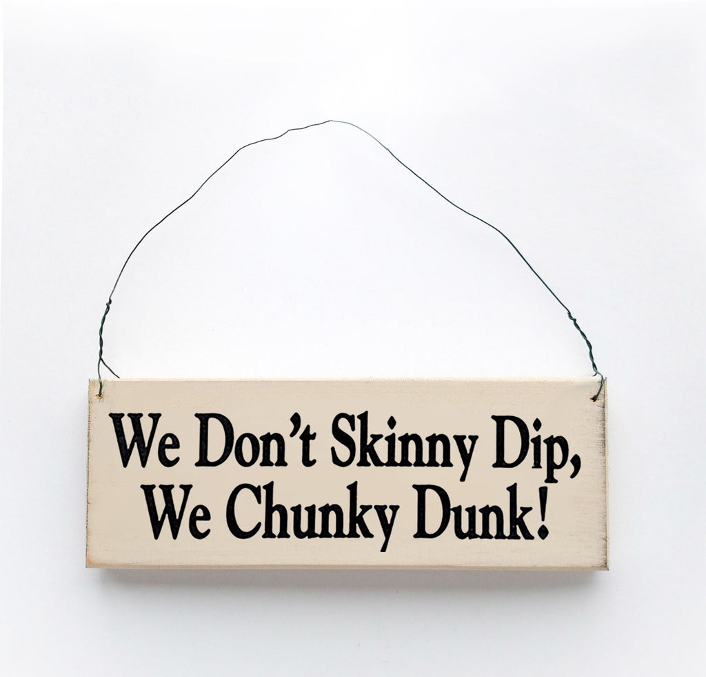 Wood sign saying: We Don't Skinny Dip, We Chunky Dunk