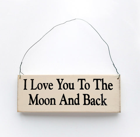 Wood sign saying: I Love You to the Moon and Back