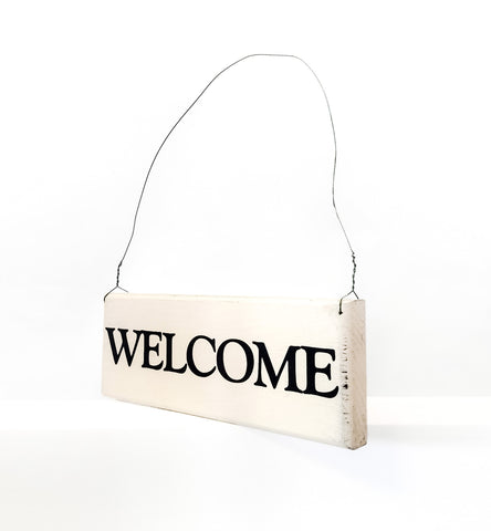 Welcome wood sign with saying