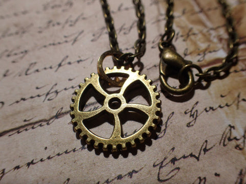"Antiqued Bronze Steampunk spiral gear necklace, 24"" chain with 3/4"" 18mm dia gear"
