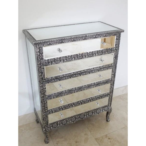 Blackened silver embossed metal mirrored tallboy chest of drawers