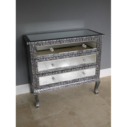 Blackened silver embossed metal mirrored chest of drawers